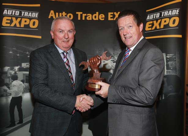 Automotive Publications Padraic Deane presents David Dempsey from Crown Paints/Standox, with an Innovation Award at the  Auto Trade EXPO 2015 awards in Citywest Hotel.