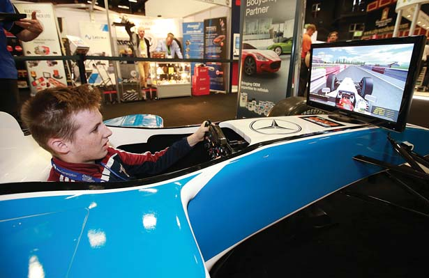 Pictured at the PPG Industries stand at the Auto Trade EXPO 2015 exhibition in Citywest, was Cillian D'Arcy from D'Arcy Tyres Offaly as he  tried his hand at the F 1 simulator.